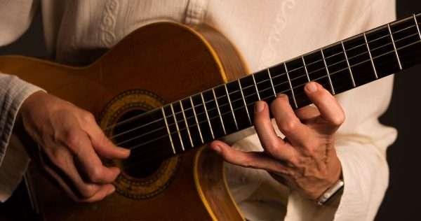 Guitarist Steve Osman playing classical guitar